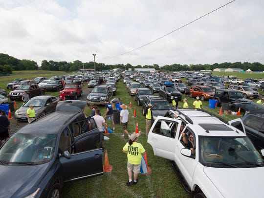 Campers vehicles are checked by security upon arrival to the Firefly Music Festival in Dover last year.