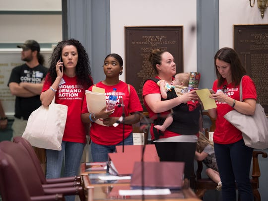 Members with Moms Demand Action gather inside the Senate Chambers before the vote on Senate Bill 163 concerning assault weapons at Legislative Hall in Dover.