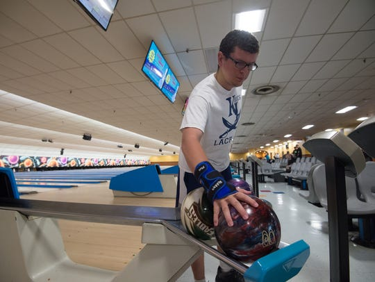 Zachary Martin of Newark prepares to throw a practice ball Saturday at Bowlerama in Newark. Martin will be competing with his teammates in bowling at the 2018 Special Olympics USA Games in Seattle.