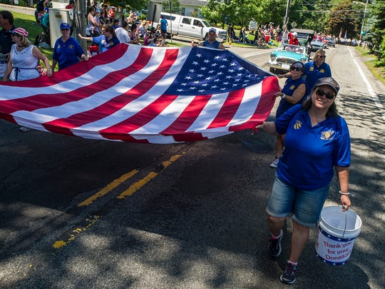 Flag bearers and a giant flag at the Annual Randolph Kiwanis Freedom Festival Parade in Randolph, June 30, 2018.  Photo by Warren Westura for the Daily Record.