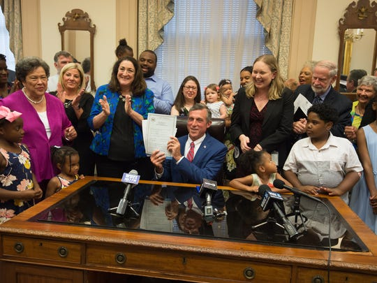 Governor John Carney signs into law 12-week paid family