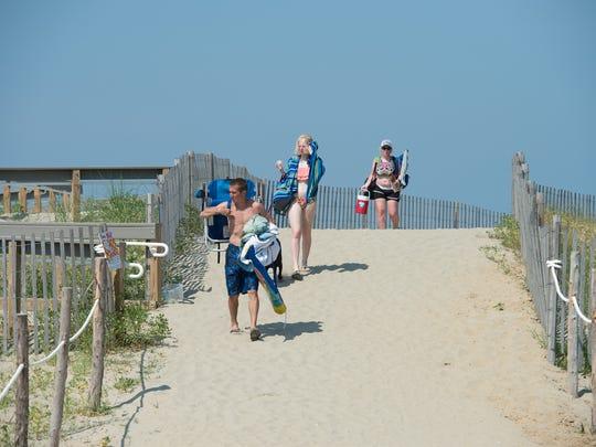 Visitors leaving the beach at Broadkill.