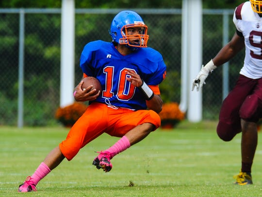 Delmar quarterback Shane Leatherbury breaks for a gain against Milford at Delmar High School on Saturday afternoon.