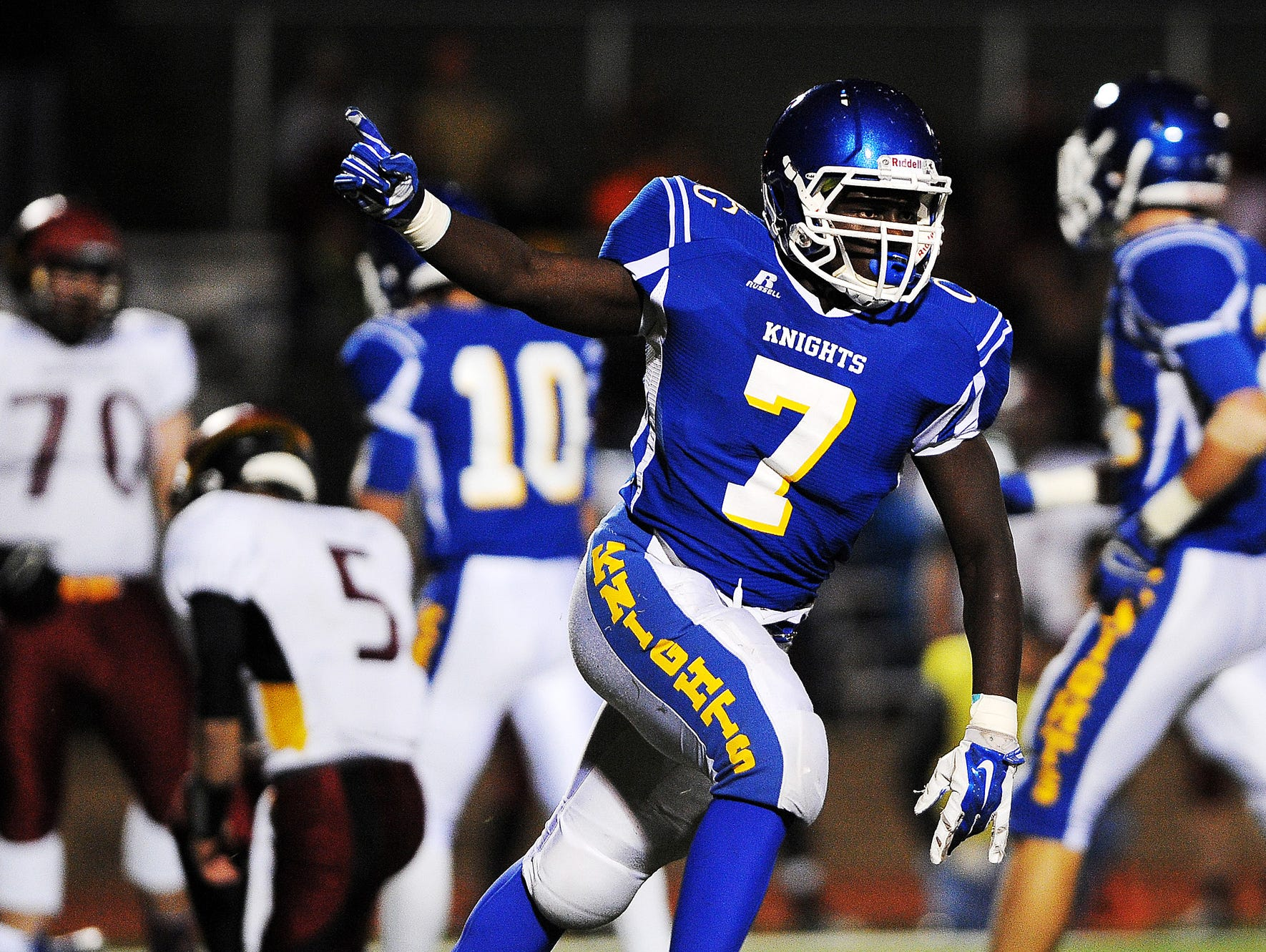 O'Gorman's Jimmy Pio (7) reacts after the Knights recovered a fumble during a game against Roosevelt on Friday, Oct. 17, 2014, at McEneaney Field on the O'Gorman High School campus in Sioux Falls, S.D.