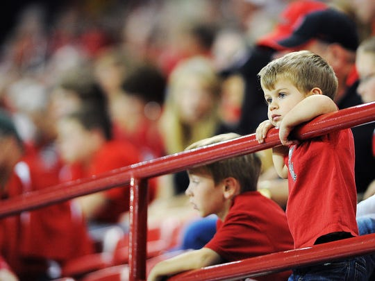 A young USD fan looks on during the first half of a game against North Dakota State in 2014.