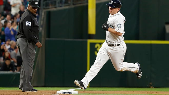 Seattle Mariners' Kyle Seager rounds the bases after hitting a three-run home run against the New York Yankees in the fourth inning of a baseball game, Monday, Aug. 22, 2016, in Seattle.