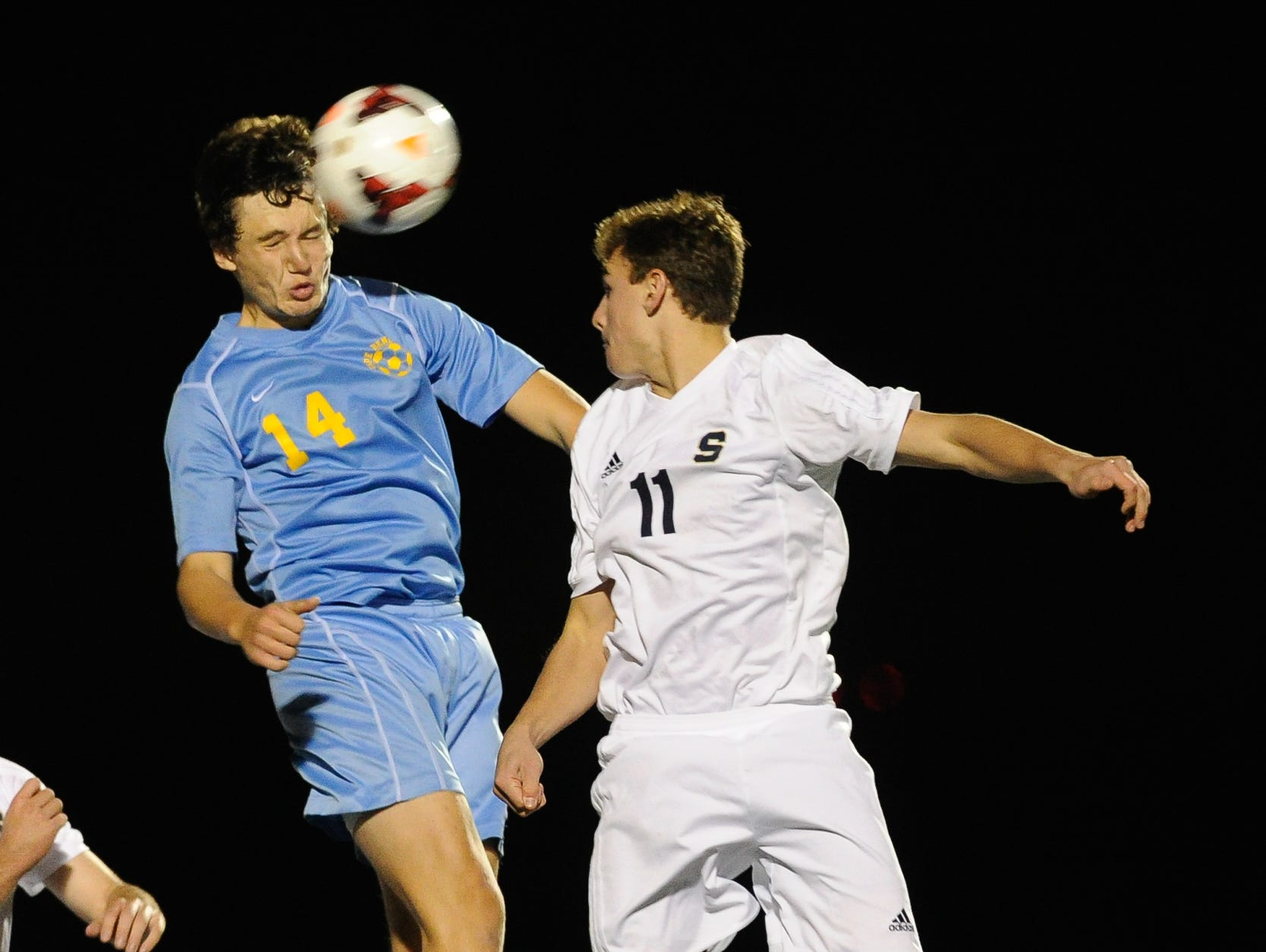 Cape Henlopen's #14 Zachary Gelof heads the ball over Salesianum's #11 Trevor Clare in the second half of the DIAA Division I soccer semifinal game at Smyrna High School.