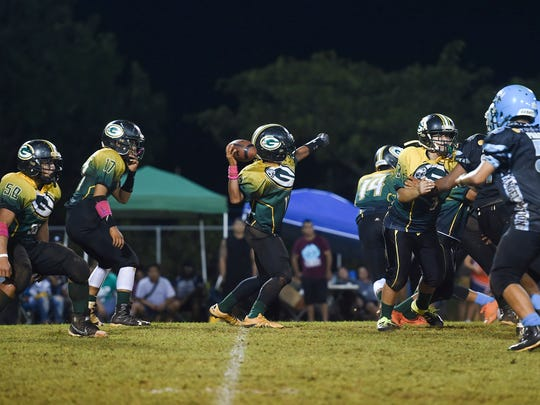 Guam Packers quarterback Dreyvin Apatang prepares to launch a pass against Hal's Angels during their Triple J Guam National Youth Football Federation Matua division championship game at Hal's Angels Field in Dededo on Nov. 4, 2017.