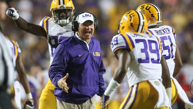Sep 10, 2016; Baton Rouge, LA, USA;  LSU Tigers head coach Les Miles congratulates Russell Gage (39) after a tackle against the Jacksonville State Gamecocks during the second half at Tiger Stadium. LSU defeated Jacksonville State 34-13. Mandatory Credit: Crystal LoGiudice-USA TODAY Sports