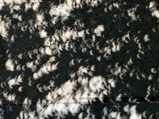 Brittany Salazar captured this photo of shadows cast during the solar eclipse of Aug. 21, 2017, at 12:53 p.m. in San Angelo, Texas, on an iPhone 6s.