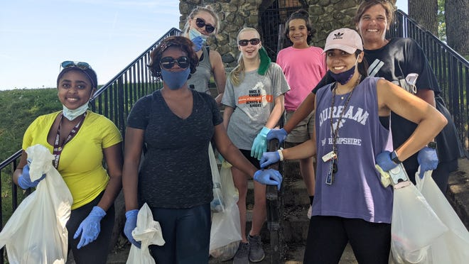 Tamisha Civil (second from left), running for the 6th Norfolk District seat, led a group of volunteers to clean up D.W. Field Park.