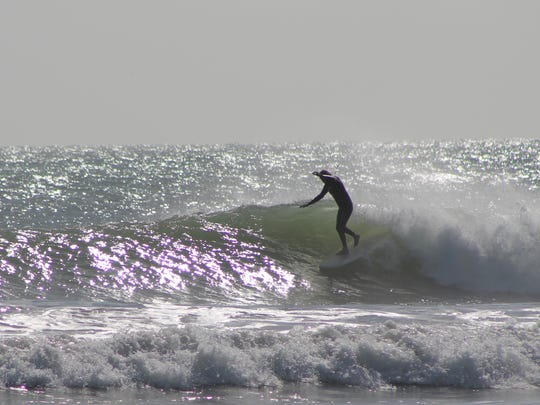 The first good swell of 2016, combined with offshore winds are attracting plenty of happy surfers to Space Coast beaches.