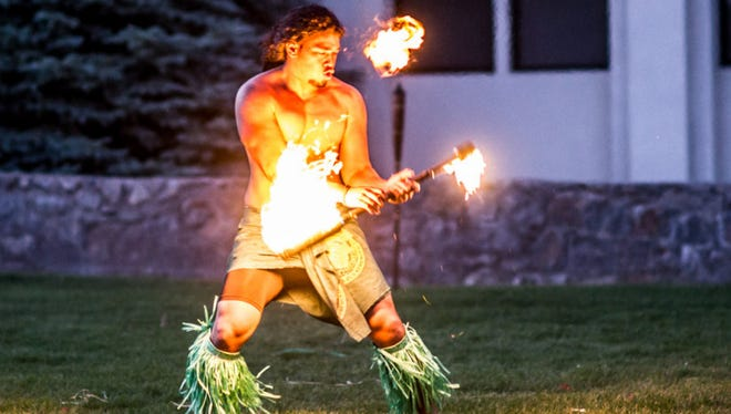 A fire dancer performed as part of the 2014 Polynesian night event held at Old James Stadium on the campus of Western New Mexico University in Silver City.