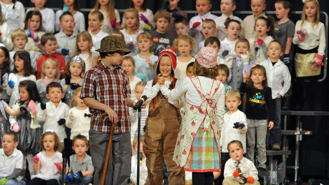 "Christian Wilson, Jonathan Woodward and Kamryn McGinnis perform their part of ""The Mitten"" during the Conesville Elementary Christmas Musical Wednesday night at River View High School Auditorium."