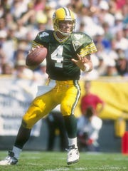 Brett Favre looks to pass during a 1993 game.