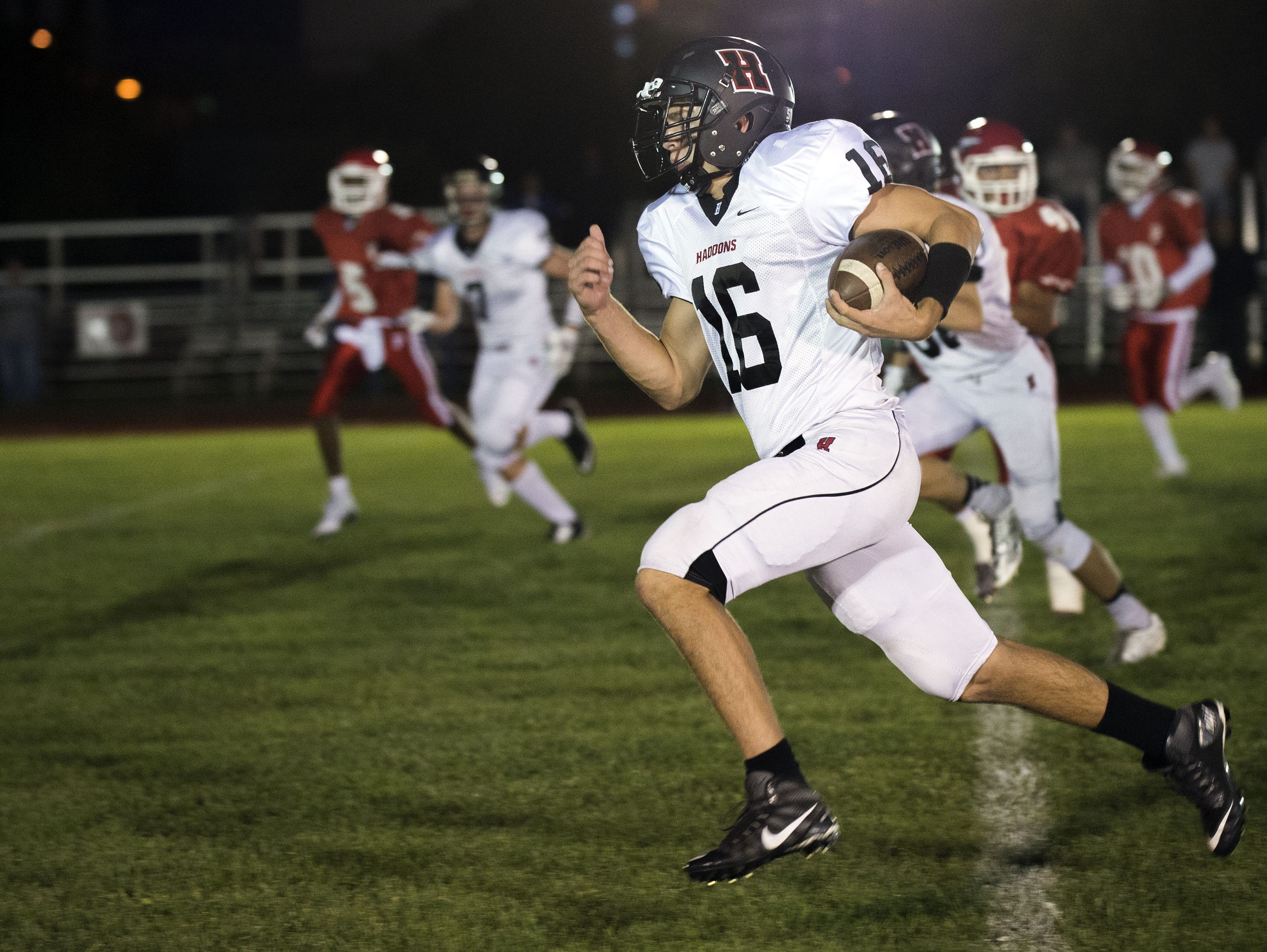 Haddonfield's Tommy Kadar rushes to the end zone Friday night against Paulsboro.