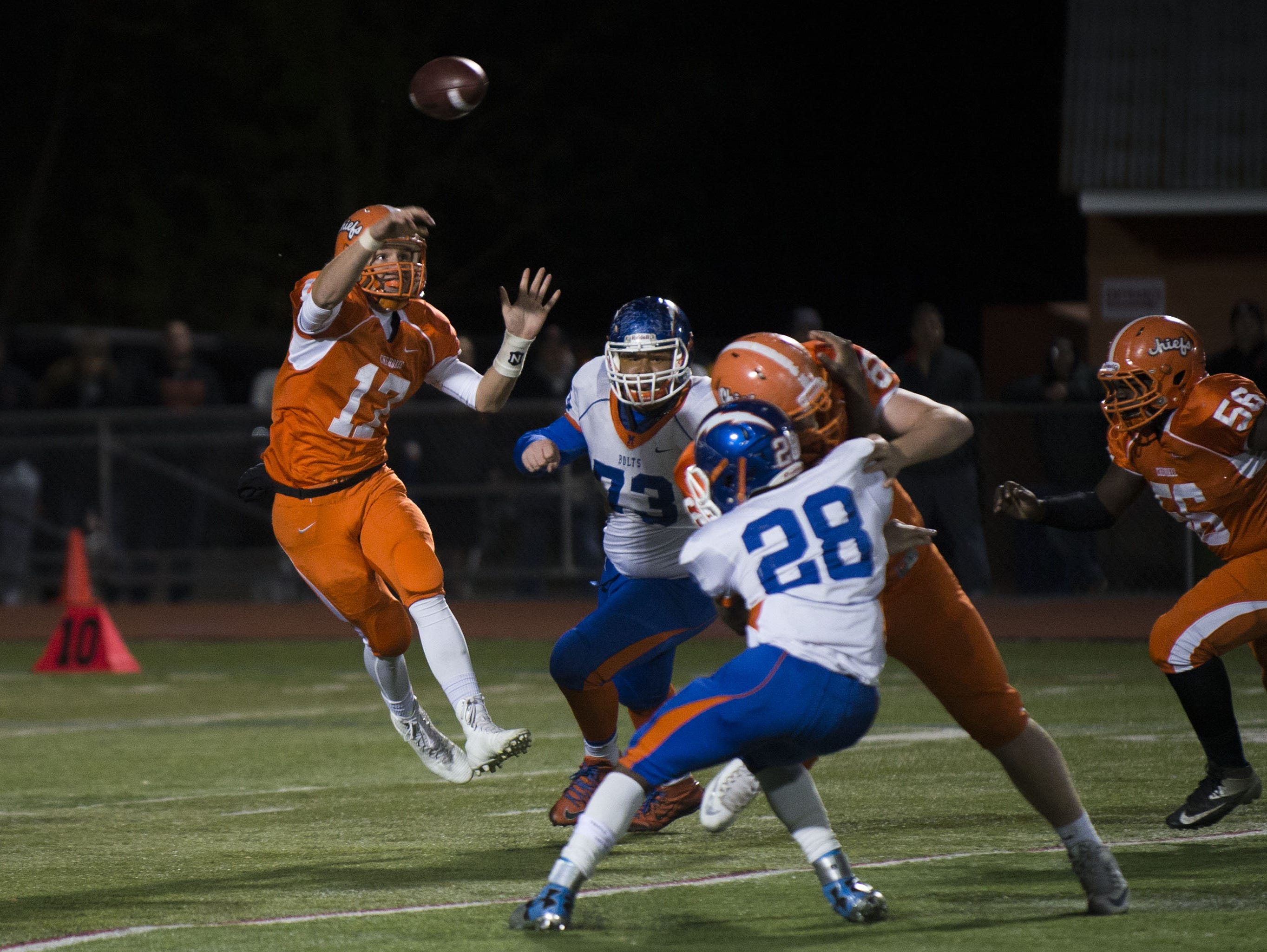 Cherokee quarterback Jacob Bodine leaps as he tosses a pass in Friday's S.J. Group 5 playoff game against Millville.
