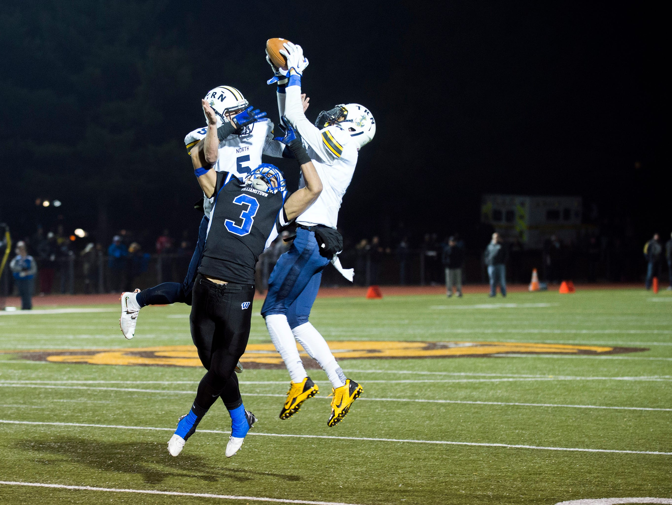 Williamstown's Eric Smith (3) can't make the grab as Toms River North intercepts the ball to end the game Saturday, Dec. 5 at Rowan University in Glassboro. Toms River North won 14-7, claiming the South Jersey Group 5 title.