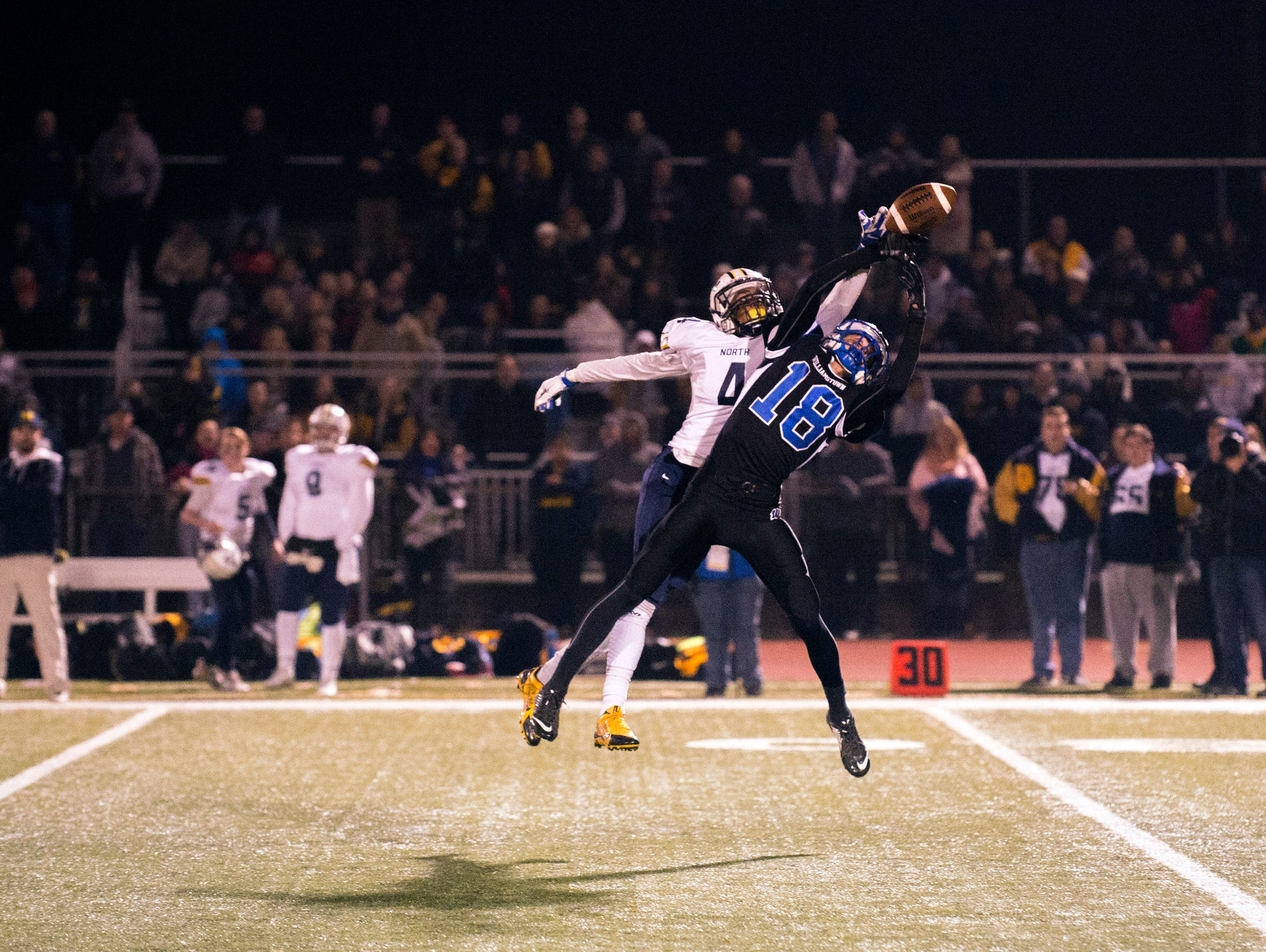 Toms River North's Darrion Carrington (4) breaks up a pass intended for Williamstown's Victor Ruggiano (18) Saturday, Dec. 5 at Rowan University in Glassboro. Toms River North won 14-7, claiming the South Jersey Group 5 title.