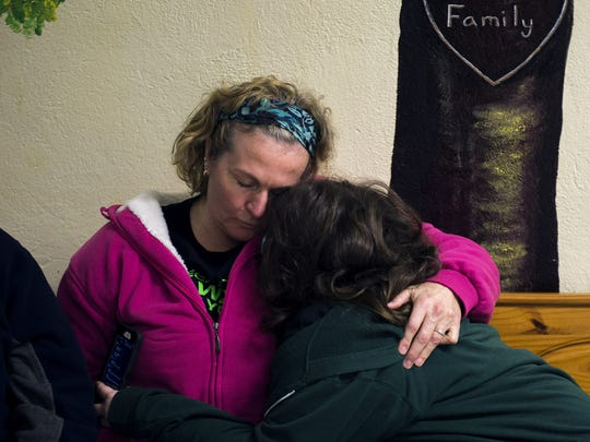 Barbara DeSimone, left, hugs her daughter Cecilia DeSimone, 11, inside Edgarton Christian Academy Thursday, Dec. 31 in Newfield. They recently lost their home in a fire, but have received enormous support from the community and school.