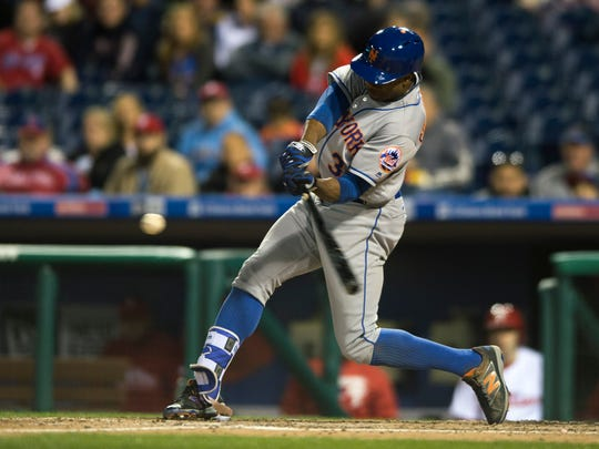 Mets' Curtis Granderson hits a home run against the Phillies Tuesday, April 19 in Philadelphia. The Phillies lost 11-1.