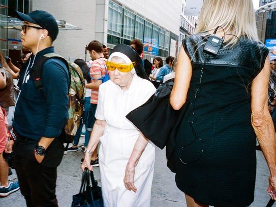 Street photographer Daniel Arnold captured a nun in