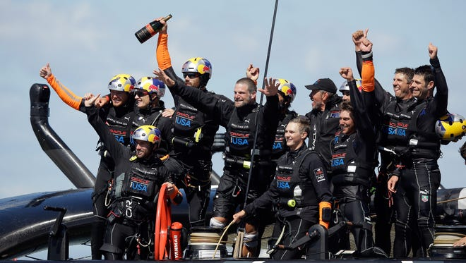 Oracle Team USA celebrates after its second straight America's Cup title.