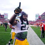 Dec 21, 2014; Tampa, FL, USA; Green Bay Packers running back Eddie Lacy (27) celebrates as the Packers beat the Tampa Bay Buccaneers 20-13 at Raymond James Stadium. Mandatory Credit: David Manning-USA TODAY Sports ORG XMIT: USATSI-180476 ORIG FILE ID:  20141221_pjc_mb2_132.JPG
