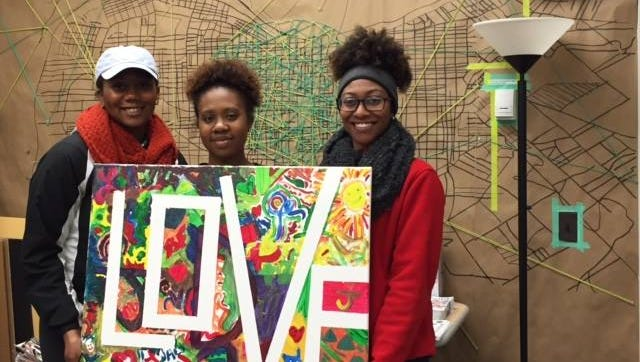 Members of the Louisville Chapter of Delta Sigma Theta sorority, long-term supporters of PEACC, donate a painting to the organization in April 2016.