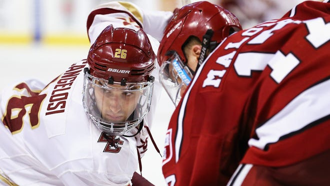 Estero native and Boston College star Austin Cangelosi (No. 26) prepares to face off against Harvard's Sean Malone during the third period at TD Garden on February 1, 2016.