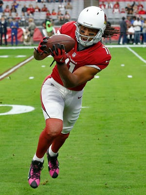 Larry Fitzgerald reaches the milestone in just 214 games compared to Rice (221 games).