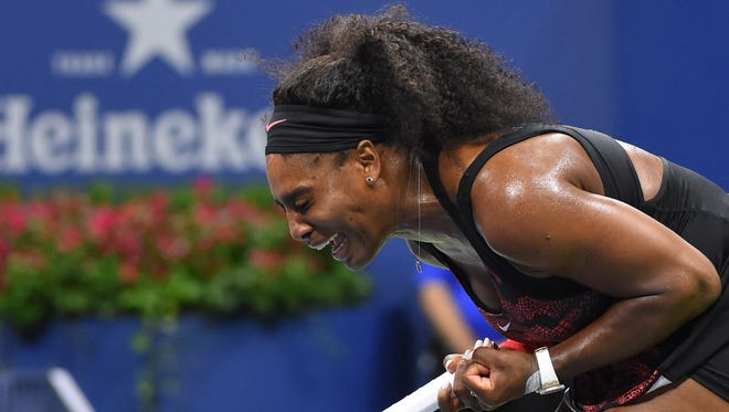 Serena Williams of the USA winning the 3rd game in the second set against  Venus Williams of the USA on day nine of the 2015 U.S. Open tennis tournament at USTA Billie Jean King National Tennis Center.
