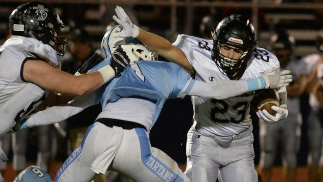 Bishop Eustace's Andrew Ciampi breaks a Highland tackle as he carries the ball during Friday night's game.11.03.17.