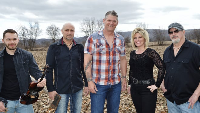 The Brian Dean Moore Band, which specializes in high-energy country, will be among the artists playing Rockin' for the Barnyard this Sunday, July 23, at the Inn at Millrace Pond in Hope.  Also on the bill are the band Electric Gumbo and singer-songwriter Paul DiGiorgio.  The event benefits the Barnyard Sanctuary in Columbia, which is home to rescued farm animals.