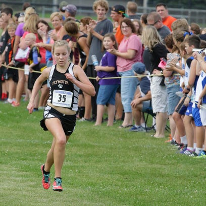 Sophie Bolich nears the finish line at the Kiel Invitational Cross Country Meet Thursday September 3, 2015 at Kiel High School.