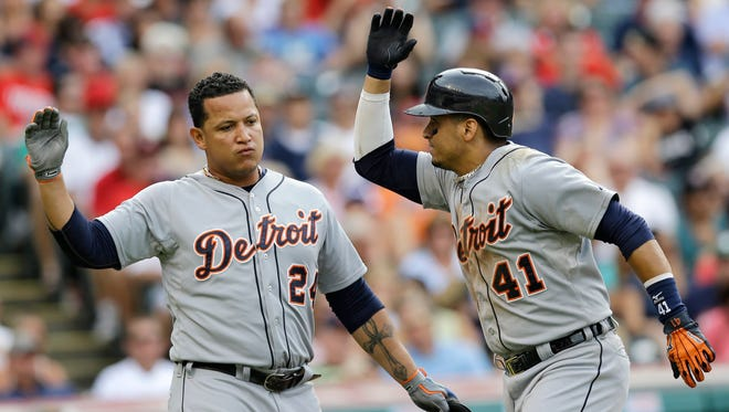 Detroit Tigers' Victor Martinez, right, and Miguel Cabrera celebrate after Martinez hit a two-run home run against Cleveland on Sept. 1, 2014. Both players will be returning from injuries in the 2015 season.