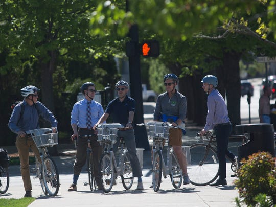 Des Moines city officials, members of the Des Moines Bicycle Collective and Former Minneapolis Mayor R.T. Rybak, take a bike tour to learn about the city's efforts to improve biking and walkability on Wednesday, May 4, 2016.