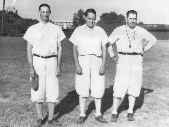 At right General Robert Neyland poses for a photo in