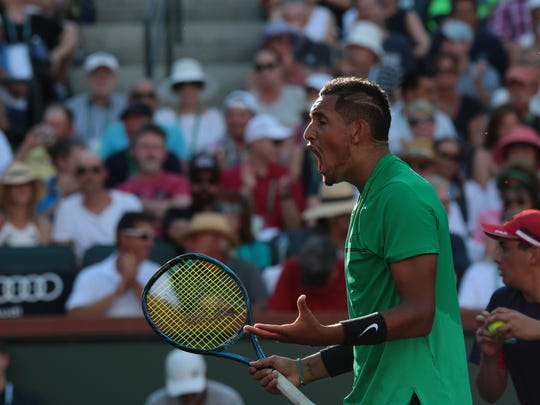 Nick Kyrgios, of Australia,yells in frustration during