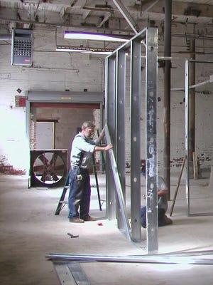 Bob Wilson working in his shop at the  Garnerville Arts & Industrial Center .