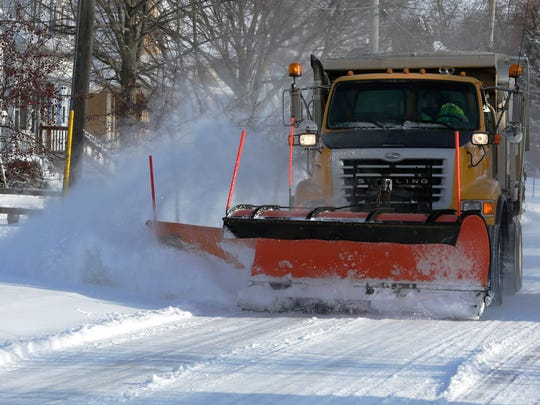 A city of Oshkosh snow plow clears Iowa Street in this 2018 file photo.