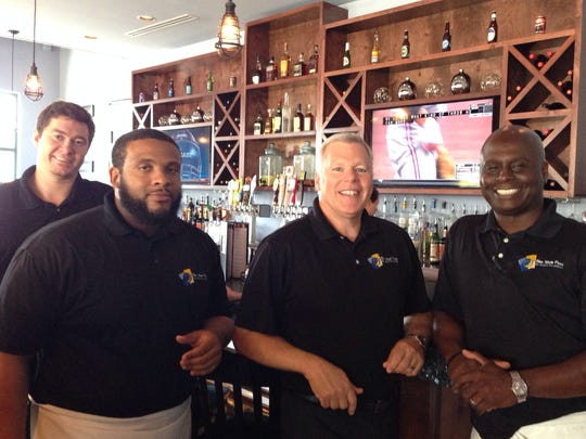 From left: Bryan Charles, kitchen manager; Adrian Mitchom II, general manager, Brett Hull-Ryde, partner; and Kelvin Smith, founder and partner.