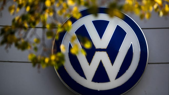 FILE - In this Oct. 5, 2015, file photo, the VW sign of Germany's Volkswagen car company is displayed at the building of a company's retailer in Berlin. Hundreds of millions of dollars in settlements and fines over unintended acceleration in Toyotas and faulty ignition switches in General Motors' vehicles provide a glimpse of what consumers and the government might get from Volkswagen for cheating on diesel emissions, legal scholars say. (AP Photo/Markus Schreiber, File)