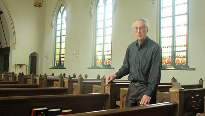Sexton, the caretaker of the building, Carroll Neidhardt stands in the nave of St. Paul's Episcopal Church. The church will have its last Easter service on Sunday after being around for 164 years.