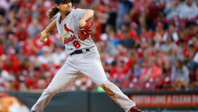 Former Red, St. Louis Cardinals starting pitcher Mike Leake (8) delivers a pitch in the bottom of the sixth inning of the MLB National League game between the Cincinnati Reds and the St. Louis Cardinals at Great American Ball Park in downtown Cincinnati on Friday, Aug. 4, 2017. The Reds won the opening game of the home series, 3-2, over the Cardinals.