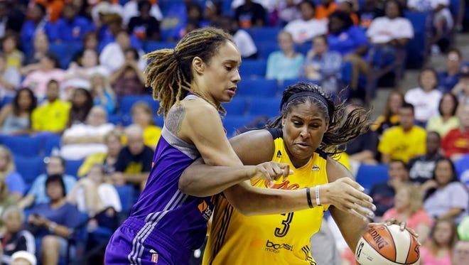 Tulsa Shock's Courtney Paris, right, is pressured by Phoenix Mercury's Brittney Griner during their WNBA basketball game.