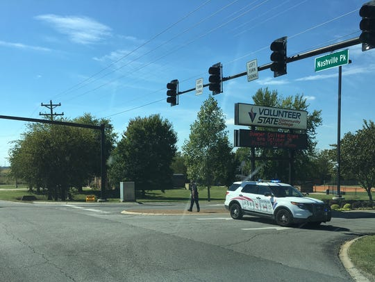A police officer blocks the entrance to Vol State Gallatin