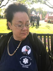 Robin Yuhas at the Clifton 9/11 memorial remembering her friend John Skala, a Port Authority officer killed in the World Trade Center attack.