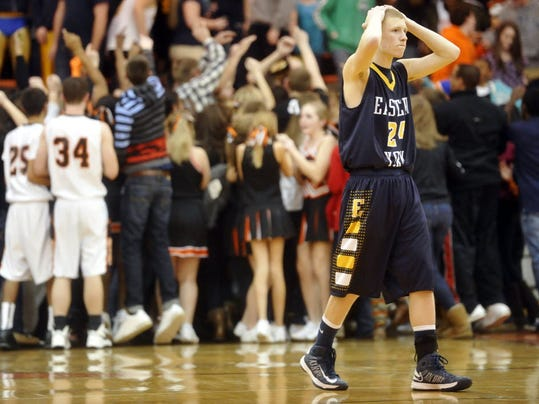Eastern York's Cody Bollinger walks off the court as York Suburban students surround their players after York Suburban boys defeated Eastern York 62-60 at home on a three-point buzzer-beater by C.J. Boxley on Friday, Feb. 1, 2013. The Knights have a chance to make up for the loss Tuesday at home against Bermudian Springs. (DAILY RECORD/SUNDAY NEWS -- CHRIS DUNN)