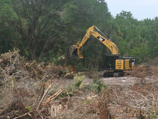 Crew clears 14-acre property to build a Publix Super Market at the corner of State Road 50 and Barna Avenue in Titusville.